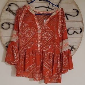 Bell sleeve tunic style top